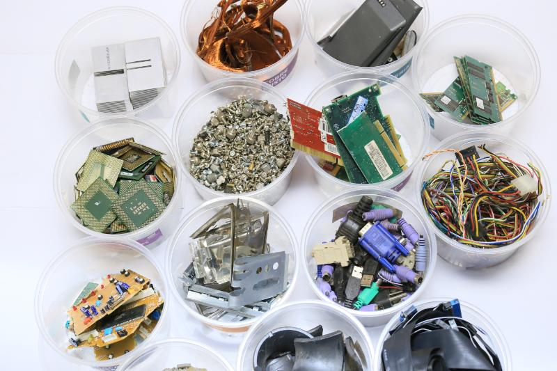E-Waste components being sorted into different containers.